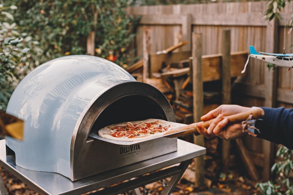 Delivita blue pizza oven garden landscape 2