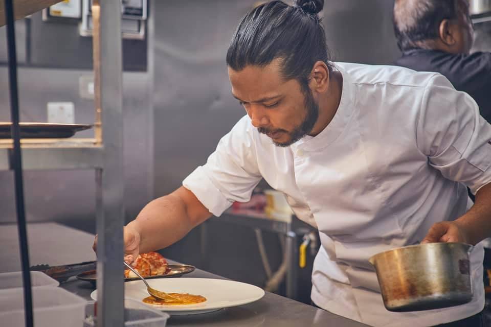 Chef Jay plating up Lavang Sheffield